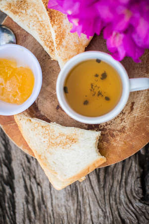 breakfast cup: Toast with pineapple jam and tea. Breakfast Rustic