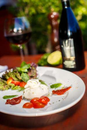 italian dish: Traditional Italian dish of burrata mozzarella