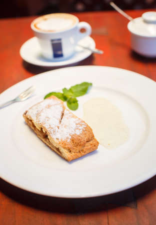 strudel: Apple strudel with sauce and coffee Stock Photo