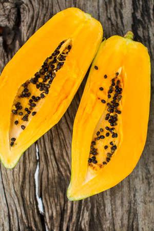 enzymes: Papaya on wooden board