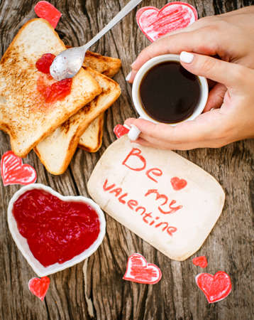 hand jam: Toast with strawberry jam. Be My Valentine white message card with hand made hearts.