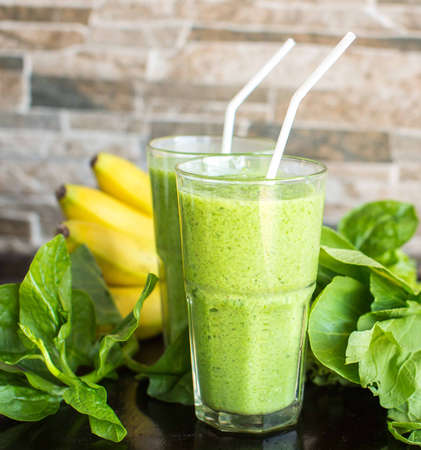 Fresh green smoothie with banana and spinach Stock Photo