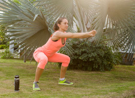 working woman: beautiful woman working out in summer park