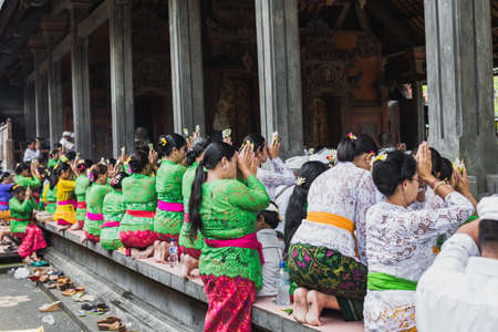 performed: UBUD, BALI - MARCH 8: Unidentified people during performed Melasti Ritual before Balinese Day of Silence on March 8, 2016 in Ubud, Bali, Indonesia. It is a day of silence, fasting, and meditation. Editorial