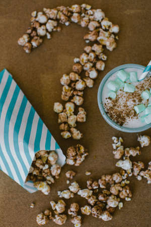 eating questions: Chocolate Popcorn and Coffee with Marshmallows Cinema Concept Question Mark Stock Photo