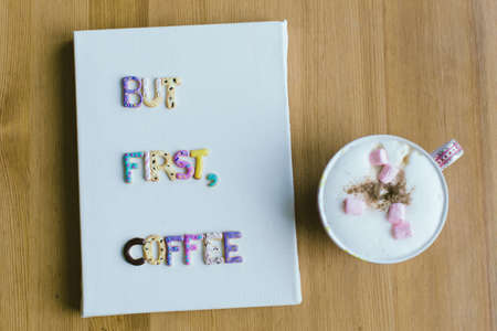 style advice: Phrase But first coffee written with sweet plastic letters