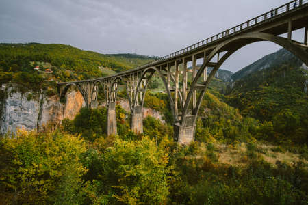 Durdevica Tara arc bridge in the autumn mountains, Montenegro.