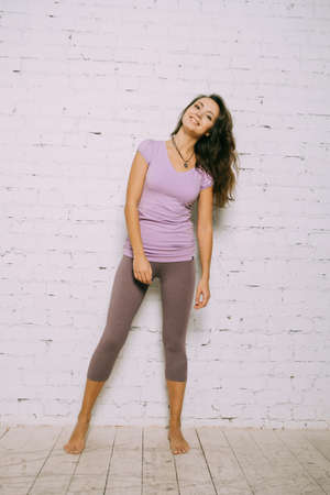 Young attractive woman in a yoga clothing Stock Photo
