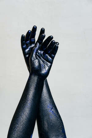Black Hand of death on a gray background, the walking dead Stock Photo