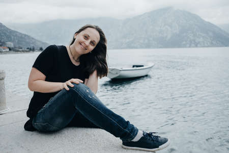 portait: Portait of woman enjoying spring time at the bay in Montenegro.