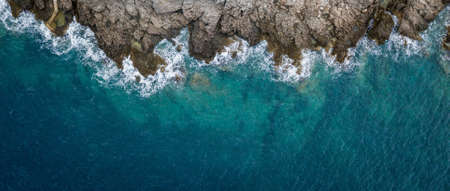Aerial view of sea waves and fantastic Rocky coast, Montenegro  Stock Photo