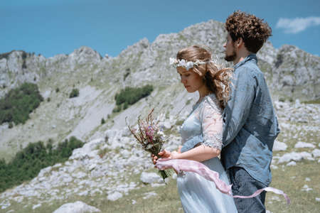 Stylish Romantic  couple against the background of the mountains. Stock Photo