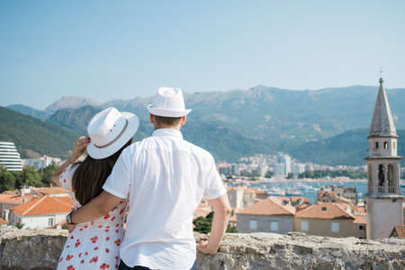 Back view of romantic couple looking to the old town Budva, Montenegro