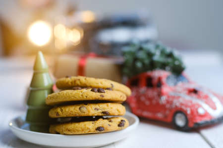 Christmas cookies with chocolate and cocoa on the background of candles.