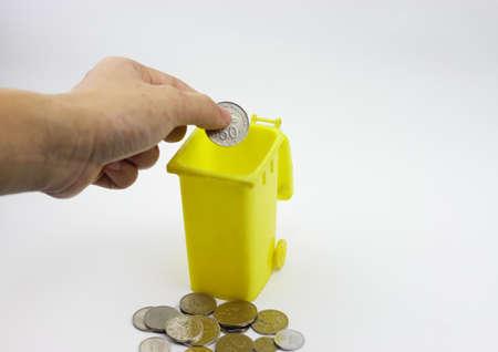 coin box: Hand put coin in coin box Stock Photo