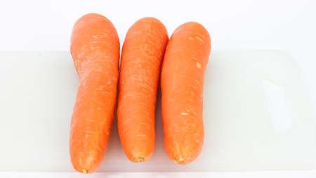 Carrot on cutting board photo