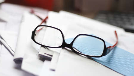 spectacle: A spectacle on top of papers Stock Photo