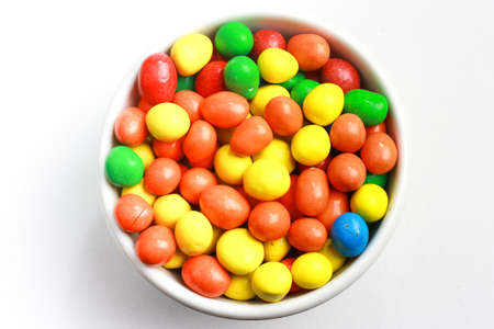 Colourful candy in glass container photo