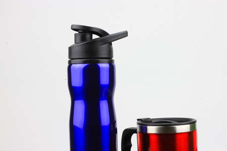 tumbler: A blue tumbler and red mug isolated