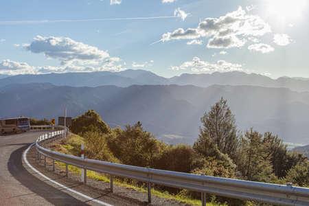 Mountain road through New Zealand with nice sun light