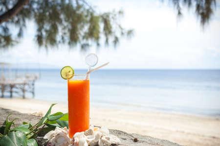 Tropical papaya juice on the beach