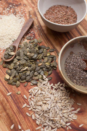 mixed seeds on wooden background