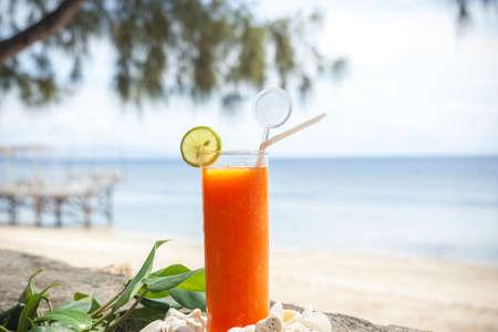 tropical papaya juice on the beach Фото со стока