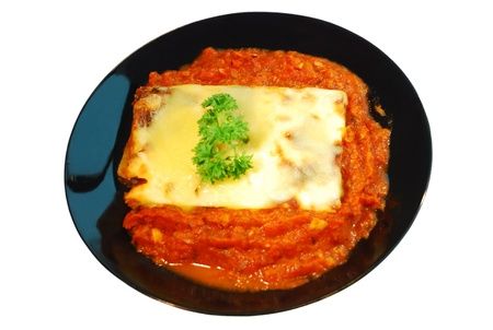Lasagna on black dish with isolated white Stock Photo