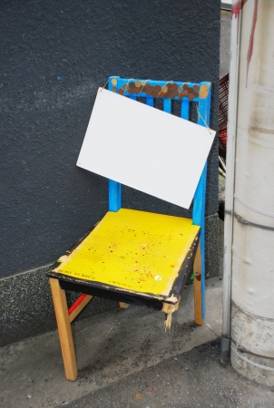 Empty sign hanging on Old broken chair