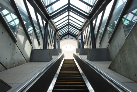 Escalator in underground passage  photo
