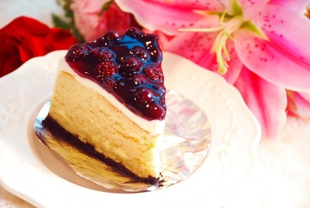 Sweet Blueberry Cheese Cake On White Dish With Flower Background Stock Photo