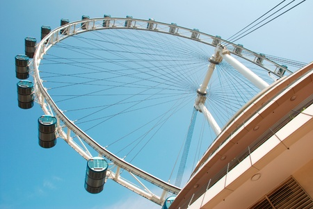 Singapore flyer against clear blue sky Editorial