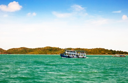 wooden ferry boat in the sea of thailand photo
