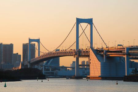 Tokyo Bay with Rainbow Bridge in evening light, Tokyo city, Japan photo