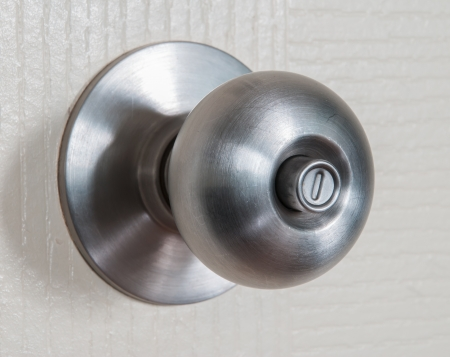 close up shot of stainless steel round ball door knob photo