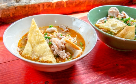 Thai street food traditional Tom Yum noodle soup with pork