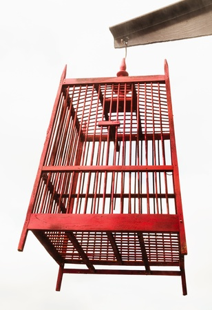 break out of prison: empty wooden bird cage isolated white