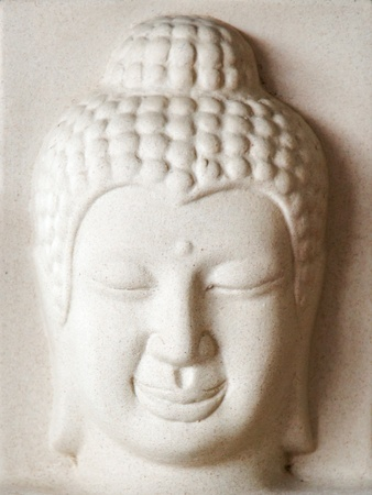 Plaster sculpture carved of Buddha face photo