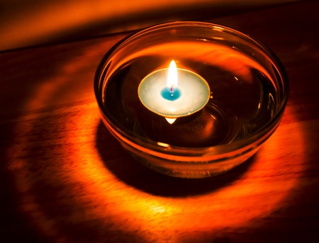 Aromatherapy candle floating in oil