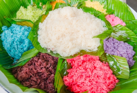 Thai dessert colorful sticky rice with egg custard on banana leaf Stock Photo