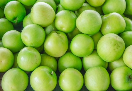 close-up of raw green apple heap in the market