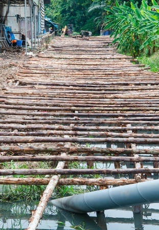 wooden bridge under construction in Thailand photo