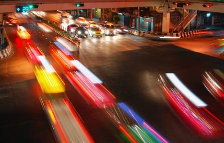 night speed traffic car light trail  at street junction of Bangkok City