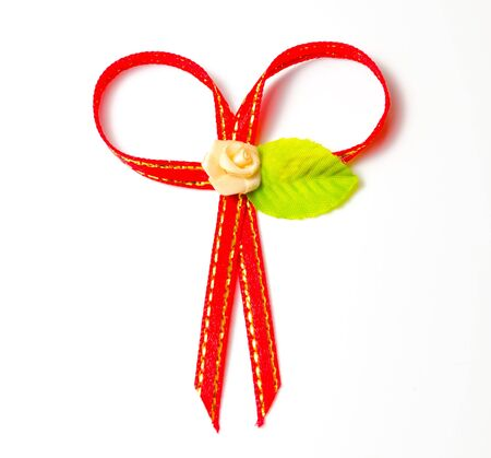 red gift ribbon bow isolated white background photo