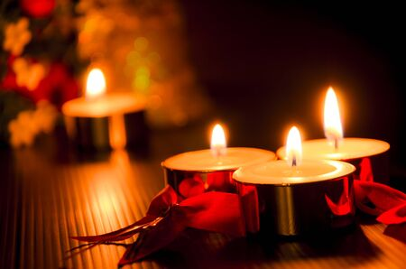 candle light: christmas candles with lights background Stock Photo