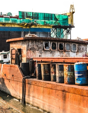 The abandoned old rusty ship in the shipyard photo