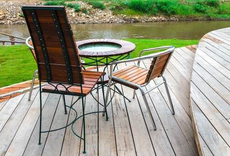 chairs and table near the pai river in thailand