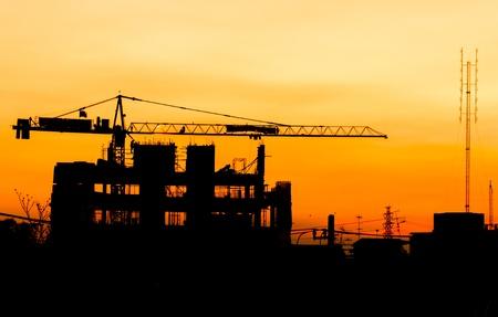 Industrial building construction cranes silhouettes photo