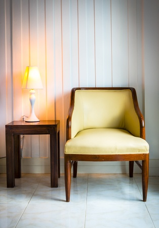 chair with desk lamp in the interior photo