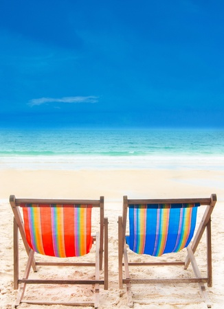 two beach chairs on beach with blue sky Stock Photo
